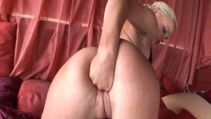 Alluring blonde sucks two massive cocks