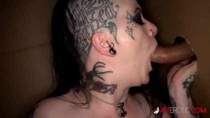 Tattooed babe Mallory Maneater sucks two cocks in a box